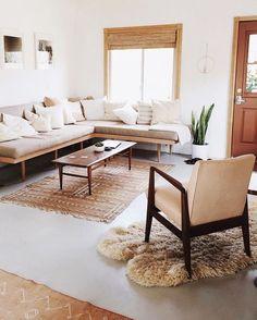 neutral living space, tonal, matchstick blind, sheepskin, corner sofa, coffee table, mid-century