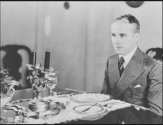"""Charlie at the table… (I am not sure what this photo was for, any ideas?) I am guessing it to be the late 1920s?) eta; via Chaplin in Pictures """" Re: the photo of Charlie at the table. I believe this is one of a series of photos that were taken at Charlie's home c. 1925 or 1926 by the Apeda studio. You may have seen the other shots: one of Charlie on a couch lighting a cigarette (one of my favorites) and a couple of him at a desk pretending to write. I believe they are ..."""