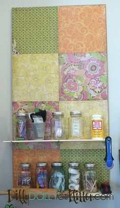 Pegboard work space storage - using scrapbook paper to cover the 2' x 4' pegboard.  Great idea! #scrapbooking #diy #crafts