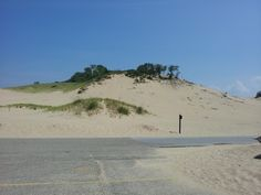 Warren Dunes State Park, where you can hang glide from the sand dunes. Looks like the sand in moving in on the parking lot.