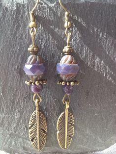 Longues boucles d'oreilles hippie chic et breloque plume bronze : Boucles…