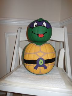 Teenage Mutant Ninja Turtle Donatello Pumpkin: I made this using artificial pumpkins from the craft store.  For an added touch, I used glow in the dark paint on Donatello's eyes and also on the D on his belt.  I made it 3-D so the paint goes all around.  It did take several coats! Super fun craft for a TMNT lover or kid's october birthday!