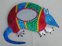 Mexican tin art - wonder if you could use tin foil and Sharpies? Gecko or lizard shape.