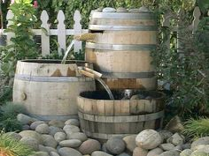 3 barrel fountain - fill with rocks so you don't use as much water
