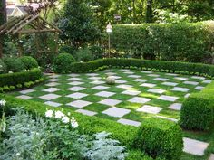 a dramatic checkerboard lawn, its impact is substantial — it's a showstopper. In this garden the alternating lawn and paving stones are set at the same height, making mowing simple.