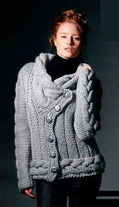 Chick! Modern! Hand-knitted designs cozy jacket with cable pattern made of 100% soft voluminous wool. The 4 threaded yarn construction gives not only