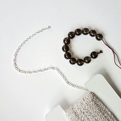 Those brown stones! Makes a simple necklace so elegant.