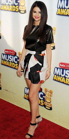 Look of the Day › April 29, 2013 WHAT SHE WORE Gomez hit the Radio Disney Music Awards in a sculpted Blumarine skirt, leather tee and ankle-strap Nicholas Kirkwood heels.