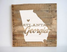 For our bedroom // state silhouette pallet art wood sign by pixelsandwood on Etsy