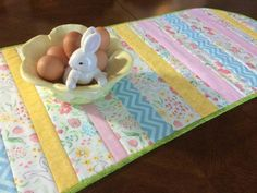 If you love hosting big dinners with your family or hanging out in the kitchen, a table runner would be great to have on your dinner table or bar! Especially one that is perfect for the Spring/Easter season! *This runner is ready for purchase, but once bought all other orders will be made to look as similar as possible to the picture (sometimes fabric varies, but we will get your approval first). It is 15 inches wide, and you have the choice of 3 lengths (35 in, 40 in, and 45 in). If yo...
