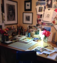 Inspiration all around, art supplies handy, fresh roses and a cozy corner to work in....