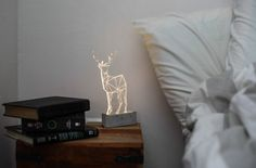 Beautiful modern reindeer lamp, laser engraved woodland themed decorative lamp.    Add modern simplicity and humour to your bedroom or chic