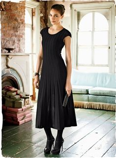 Pure elegance, masterfully engineered with lacy knit panels that sweep out to a twirling gored hemline. In drapy pima (60%) and viscose from bamboo (40%), with a round neck and shoulder-capping sleeves. Worn under the dress, our Black Body-Shaping 34'' Slip.