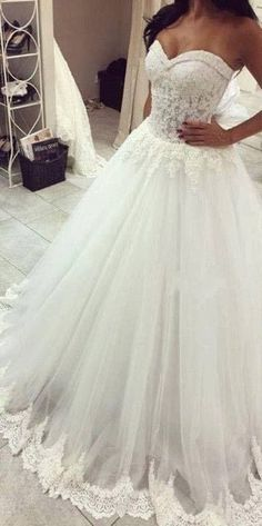 A-line Strapless Sweetheart Neck Lace Beaded Appliqued Chapel Train Ivory Wedding Gown