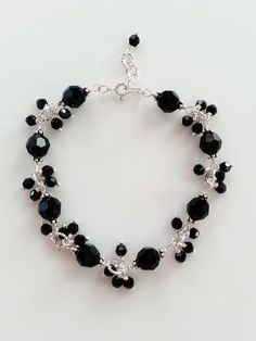 This bracelet is made with sterling silver and Swarovski crystalsin black. The bracelet measures 7.5 inches (about 19cm) with a 0.5 inch extension. All wirewor