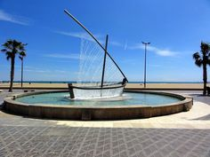 At first, the image above looks like a boat, one that is caught in a soaking surge of water, but it is in fact a cleverly designed fountain sprinkling water out of its man-made pores. Located at Playa de la Malvarrosa in Valencia, Spain and known simply as Water Boat Fountain (or Fuente del Barco de Agua in Spanish) by visitors and locals alike, the sculptural fountain creates the illusion of both the hull and the sail of a boat with liquid jets.