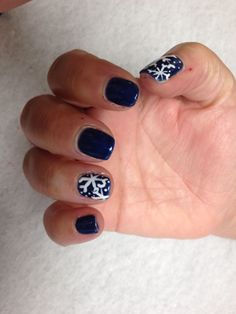 Navy with snowflake design on accent nail Oasis Salon and Spa Mill Hall Pa (570)0726-6565