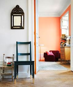 """Play with color in a spot you would never consider, like the inner edge of a door. In this scene captured by Magnus Anesand for Swedish Elle Interior, you only notice the stripe of orange when the door is opened almost all the way. Color Durazno, Apartment Painting, Color Of The Week, Peach Walls, Coral Walls, Orange Walls, Kura Bed, Piece A Vivre, Decoration Design"