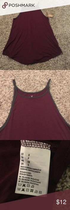 American Eagle tank American Eagle high neck tank in burgundy with dark grey piping. Brand new.                •price firm unless bundled                                      •no trades American Eagle Outfitters Tops Tank Tops