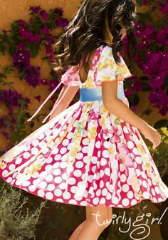 TwirlyGirl's pinwheel dress is the perfect girls occasion dress.  The ribbons spin as she twirls! $68 #girls-occasion-dress