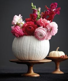 white painted pumpkin with mixed pink flowers