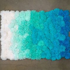 Sink your toes into a cushy pom-pom rug–it's easy to make by hand, and a great way to use up leftover yarn. Check out our step-by-step instructions and video. How to Make a Pom-Pom Rug – DIY Video Diy Pom Pom Rug, Pom Pom Crafts, Yarn Pom Poms, Pom Pom Mat, Pom Pom Hair Ties, Tulle Poms, Easy Yarn Crafts, Crafts To Do, Diy Décoration
