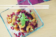 Shrimps in tamarind sauce with glass noodles and pomegranate seeds.