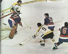 Bruins vs. Isles (in their first season).  Billy Smith in net,  Bill Mikkelson (6), and Ken Murray (5) on defence for the Islanders.  Johnny Buyck (9) and Mike Walton (11) for the Bruins.