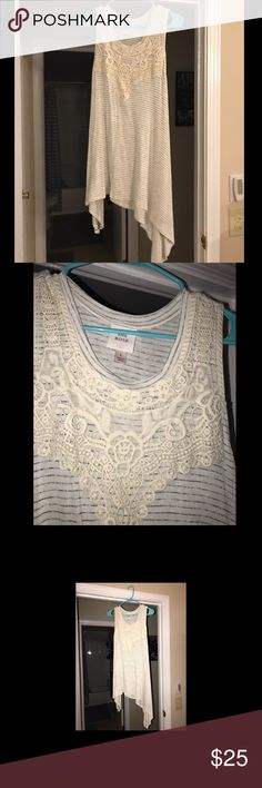 Flowy lace tank Flowy lace tank in a size large! Loose and airy and perfect with jean shorts, leggings, or some cute ripped jeans! Tops Tank Tops