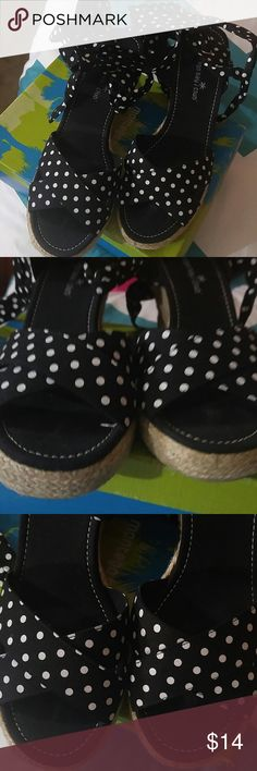 Black with white polka dot lace up sandal Size 9 1/2 black with white polka dot and the detailing is a wedge sandal that lace around the leg. Worn twice ready to sell period no holes no tears no rips no low-ball offers accepted no Trading Shoes Sandals