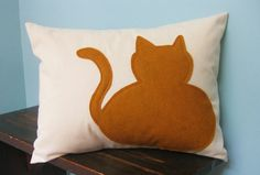 Might have to get this orange kitty pillow.....
