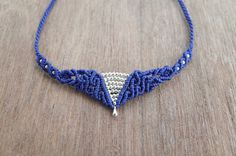 Macrame Necklace with brass beads macrame jewelry made with love Materials: -Wax cord in many color -Brass Beads Colours available: -Black -Dark Brown -Light Brown -Brownish Cream -Dark Green -Green -Wine Purple -Blue Ships worldwide from Thailand