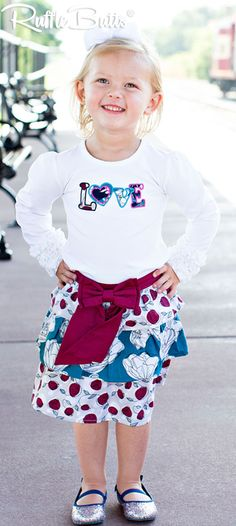 @rufflebutts- Rosie Posie Mix-Print Skirt Three tiers of ruffles adorn this sweet skirt for a funky addition to your little girl's fall wardrobe. A mulberry bow adds extra style to the skirt. Pair with Footless Ruffle Tights for a complete look!