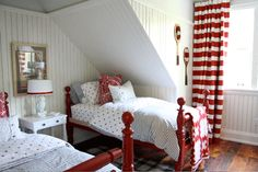 Sarah Richardson  LIam ?  white walls, grey upper and ceiling, red accents