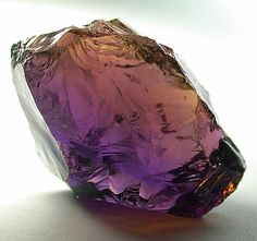 Ametrine is a form of quartz which occurs in bands of yellow and purple, a combination of the colors of amethyst and citrine.