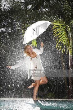 View top-quality stock photos of Woman Walking On Edge Of Swimming Pool During Tropical Rain. Find premium, high-resolution stock photography at Getty Images. Walking In The Rain, Singing In The Rain, I Love Rain, Rain Days, Umbrella Girl, Shooting Photo, Gb Shooting, Justine, Rain Photography