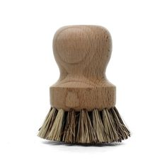 Wooden scrub brush with sturdy boar bristles. The smooth wooden contours fit the palm nicely and make scrubbing pots and pans a painless process.  Measures 7.6 x 5 cm/3 x 2in