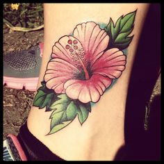 What does hibiscus tattoo mean? We have hibiscus tattoo ideas, designs, symbolism and we explain the meaning behind the tattoo. Tropical Flower Tattoos, White Flower Tattoos, Flower Tattoo On Ribs, Flower Tattoo Shoulder, Rose Tattoos, Floral Tattoos, Tatoos, Flower Tattoo Meanings, Flower Tattoo Designs