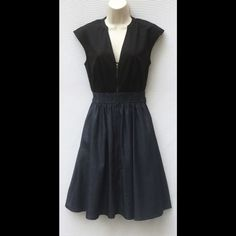 """New Eshakti Fit & Flare Zipper Dress Size 6 New Eshakti fit & flare zipper dress. Size 6 Measured flat: Underarm to underarm: 33"""" Waist: 24-32"""" Length: 38"""" Eshakti size guide for size 6 bust: 35"""" Front exposed zipper, banded collar, split front, dolman cap sleeves, side seam pockets. Bodice: cotton, woven poplin, smooth finish. Skirt: cotton, woven chambray, cross-dyed. Wash separately as chambray may bleed slightly. Eshakti Dresses Midi"""