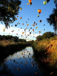 Albuquerque Balloon Festival - been there, 2002--Rode up in a balloon and got to be on a chase crew!  It was a highlight of my life!