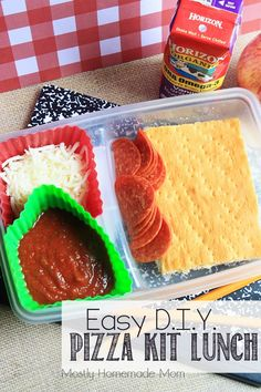 Easy DIY Pizza Kit Lunch - This fun bento style lunch is SO easy to make at home - and YOU control the ingredients!