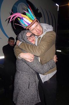 Dan Smith of Bastille. That guy in the background is like I want hugs too