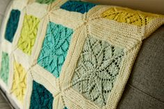I knew as soon as I saw Emily's first square I would have to knit a Vivid Blanket. It was just so pretty, a lacy flower framed by squishy garter stitch. Like little pictures put together in a beaut...