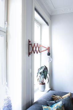 "A ""Charmingly Off-Level"" Oslo Apartment | Design*Sponge lamp: oude schaarlamp met nieuwe diamant bulb"