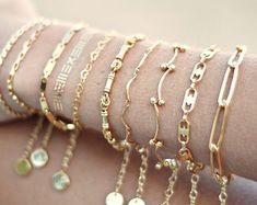 A simple dainty gold chain. ► Gold plated chain ► inches) bracelet with 1 inch extension. ► gold plated clasp and jumprings The last photo is just to show the chain itself. St Christopher Necklace, Gold Medallion, Name Bracelet, Coin Necklace, Bridesmaid Earrings, Gold Filled Jewelry, Jewelry Sets, Eye Jewelry, Sterling Silver Pendants