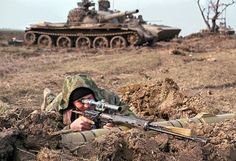 First Chechen War, Russian sharpshooter, notice the obsolete T-62 in the background.