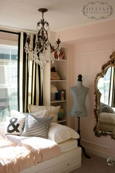 cute black and white striped curtains in a pink room with gold mirror + Chandeleir = paris feel - love for a big girl room