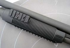 The Mossberg 590A1's fore grip gives you multiple mounting points for accessories.