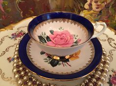 Beautiful Royal Castle Fine Bone China made in England Tea cup and saucer. Excellent condition. No chips, cracks or repaired