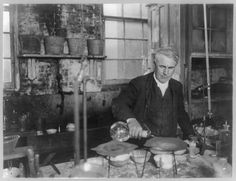 In this historic photograph, Thomas Edison pours chemicals in a laboratory. Edison, who showed a keen interest in chemistry from a young age, tested chemicals whose applications later appeared in the electric storage battery, the carbon filaments used in the light bulb, and the development of rubber. Edison first set up a laboratory for chemistry experiments in the basement of his family home when he was ten years old.